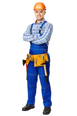 Full length portrait of young male construction worker wearing protective clothes, helmet and tool belt isolated on white background photo