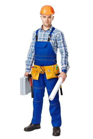 Full length portrait of young male construction worker with toolbox and drawings, wearing protective clothes, helmet and tool belt isolated on white background photo
