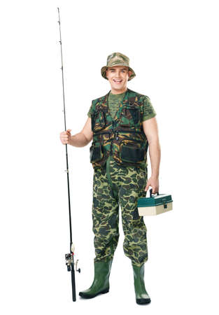 Full length portrait of a young happy laughing fisherman in camouflage holding a fishing equipment isolated on white background Фото со стока