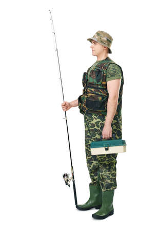 Full length side view portrait of a young fisherman in camouflage holding a fishing equipment isolated on white background photo