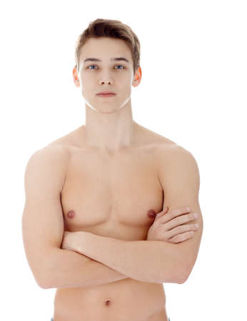 Portrait of young man with nude torso his arms crossed isolated on white background