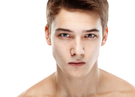 naked male body: Close-up portrait of young handsome man looking at camera isolated on white background