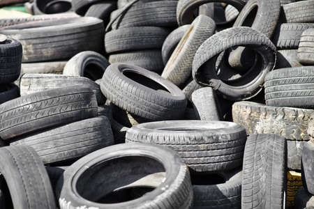 Pile of old used car tires photo