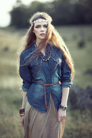 style: Beautiful hippie girl on nature. Boho fashion style