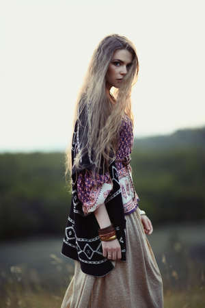 ethno: Beautiful hippie girl on nature of evening. Boho fashion style Stock Photo