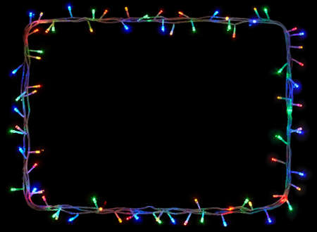 Christmas lights frame on black background with copy space.Decorative garland Stock Photo