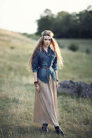 ethno: Beautiful hippie girl on nature. Boho fashion style