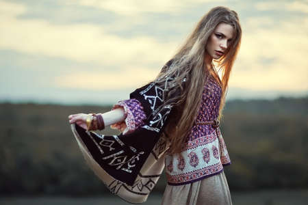 Beautiful hippie girl outdoors at sunset. Boho fashion style Archivio Fotografico