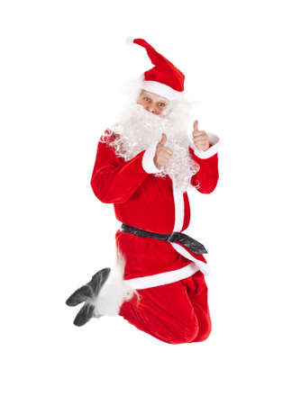 Santa Claus jumping with thumb up sign isolated on white background photo