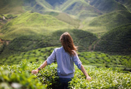 travellers: freedom girl in mountains Stock Photo