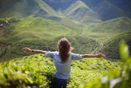 自由の女の子は山の中 写真素材