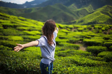 young tree: freedom girl in mountains on tea plantation