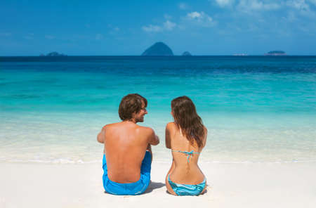 young lovers: Happy young couple in honeymoon on beach vacation in paradise Stock Photo