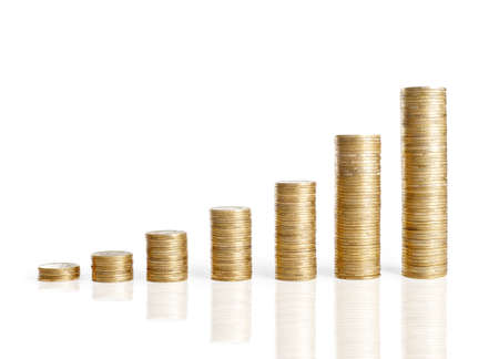 Financial growth concept,golden coins arranged as a graph isolated on white background