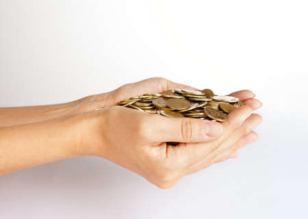 money and saving: A handful of coins in the palm of hands. Money and finance concept. Saving concept