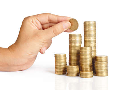 pile of coins: Hand put coins to stack of coins on white background ,Business idea, Savings,
