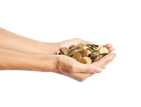 handful: A handful of coins in the palm of hands isolated on white. Money and finance concept. Saving concept Stock Photo