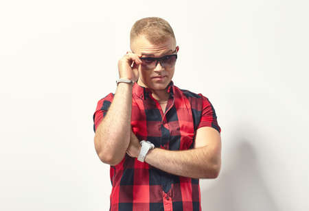stylish man: Handsome stylish man in hipster plaid shirt and sunglasses Stock Photo