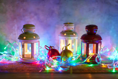 christmas garland: Christmas background with lanterns, baubles and garland Stock Photo