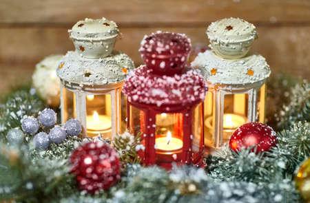 multicolored: Burning lanterns with Christmas decoration on wood background