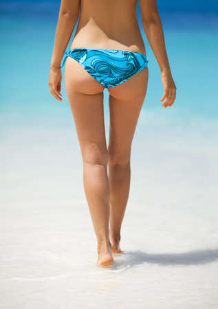 women legs: Sexy woman buttocks on the beach background