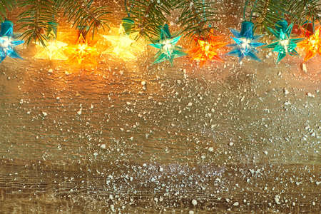 stars night: Christmas star lights on wooden background with copy space.