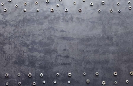 screw: metal screw nuts frame on metal texture background Stock Photo