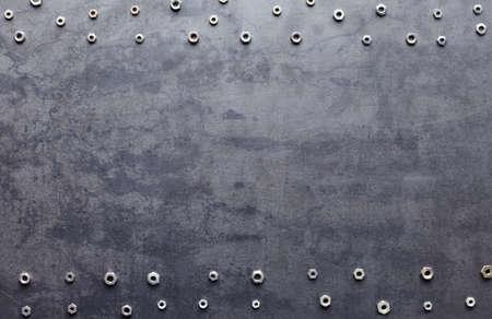tornillos: tornillo de metal marco de frutos secos en la textura de fondo de metal
