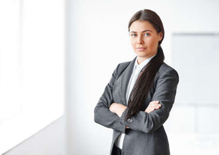woman business suit: Portrait of young beautiful business woman in the office Stock Photo