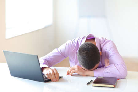 tired businessman: Tired businessman in office Stock Photo