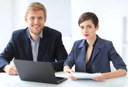 busy beard: Business people discussing ideas at meeting using laptop in the office