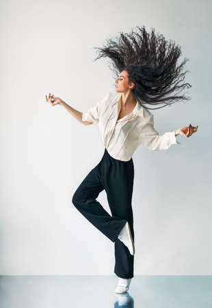 flying hair: Happy jumping dancing girl with flying hair
