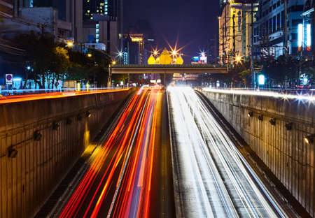 tunnel view: car light trails on long exposure at night Stock Photo