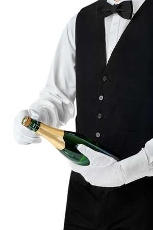 Professional waiter opening bottle of champagne isolated on white background Stock Photo