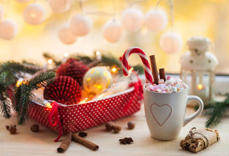 Christmas background with cup of chocolate, marshmallow and festive decoration. Winter holiday concept