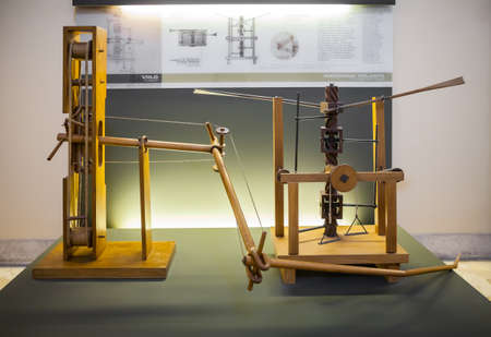 popular science: MILAN, ITALY - JUNE 9, 2016: wing-beating device with a screw and lead system models of Leonardo da Vincis scientific studies displayed at the Science and Technology Museum Leonardo da Vinci Editorial