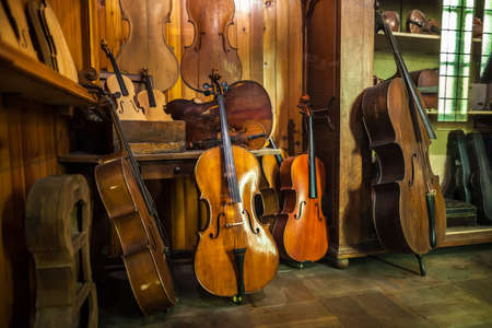 cellos: MILAN, ITALY - JUNE 9, 2016: antique violins at the Science and Technology Museum Leonardo da Vinci