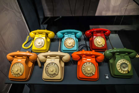 MILAN, ITALY - JUNE 9, 2016: multicoloured old phones at the Science and Technology Museum Leonardo da Vinci
