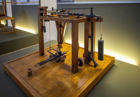 popular science: MILAN, ITALY - JUNE 9, 2016: goldforging hammer models of Leonardo da Vincis scientific studies displayed at the Science and Technology Museum Leonardo da Vinci