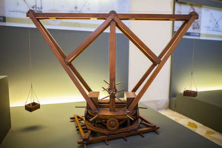 MILAN, ITALY - JUNE 9, 2016: revolving cranes models of Leonardo da Vincis scientific studies displayed at the Science and Technology Museum Leonardo da Vinci