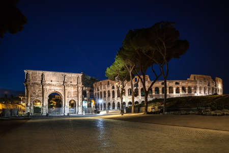ROME, ITALY - JUNE 6, 2016: Night view of The Arch of Constantine (Arco de Constantino) and Coliseum