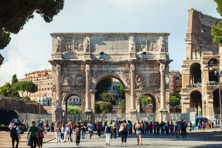 ROME, ITALY - JUNE 5, 2016: The Arch of Constantine (Arco de Constantino) stands alongside the Colosseum