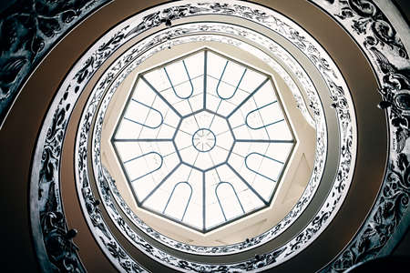 volute: Spiral staircase with glass roof in Vatican Museum. Italy Editorial