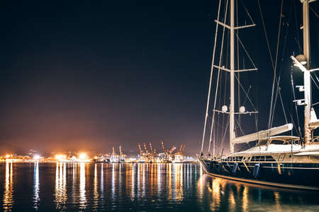 coastlines: Luxury yacht in La Spezia harbor at night with reflection in water. Italy Stock Photo