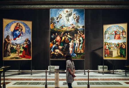 VATICAN, ROME, ITALY - JUNE 4, 2016: young woman look at paintings in the Vatican Museum