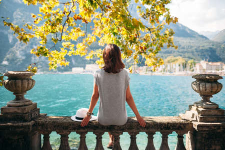 dream lake: Young woman relaxing on beautiful Garda lake. vacation concept