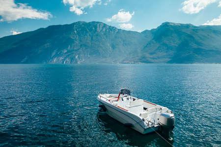 italy background: Motor boat on beautiful Garda lake, Italy. Vacation background