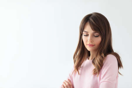 Beautiful shy woman portrait with copy space on white background Stock Photo