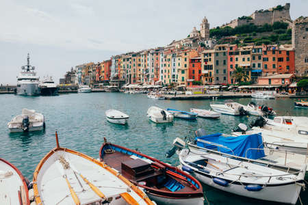 city park boat house: Beautiful colorful houses and boats in scenery italian village Portovenere. Travel background Stock Photo