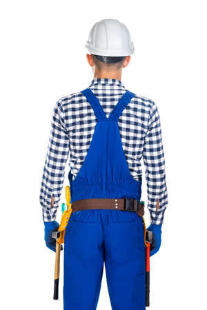 master: Back view of young construction worker in uniform and tool belt isolated on white background